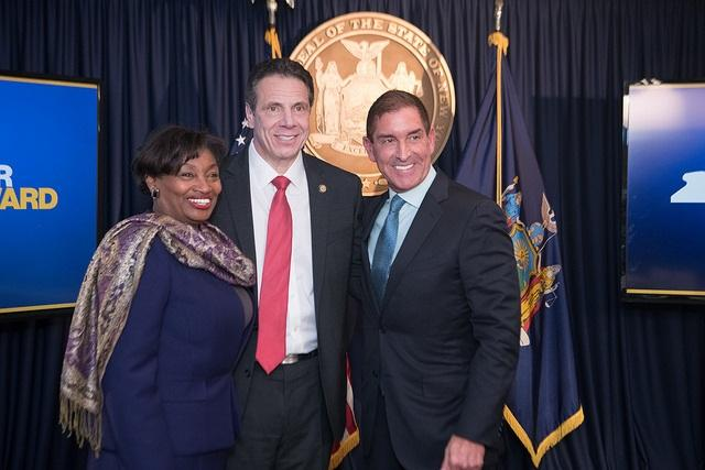 Governor Cuomo, Senator Democratic Leader Andrea Stewart-Cousins and Senate Independent Conference Leader Jeff Klein announce the Democrats' reunification agreement on Wednesday.