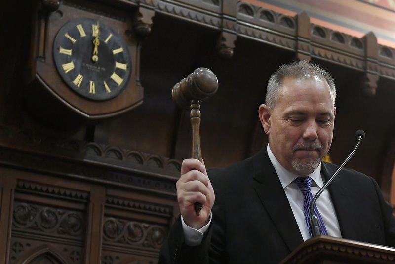 Connecticut Speaker of the House Joe Aresimowicz, D-Berlin, raises a gavel to end the legislative session at midnight at the State Capitol on Thursday in Hartford.