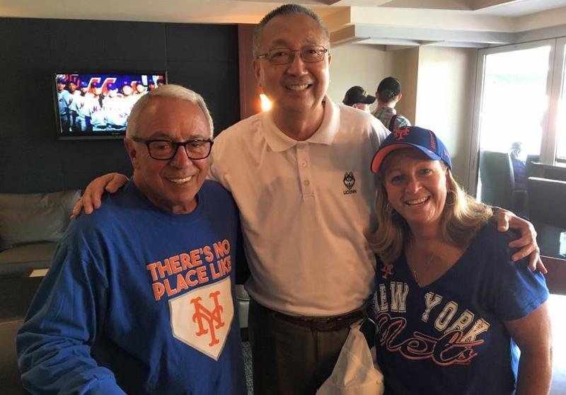 UConn Professor Michael Ego, center, with River House Executive Director Donna Spellman, right, and a fellow Mets fan at Citi Field in Queens in 2017. Dr. Ego helped start the Baseball Reminiscence League at the River House Adult Day Center in Cos Cob.