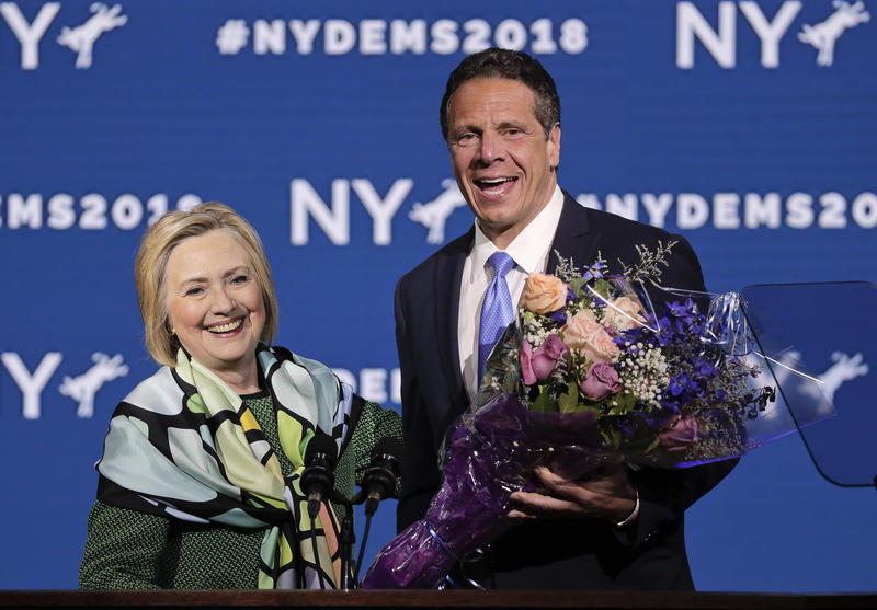 Former Secretary of State and former Democratic Presidential candidate Hillary Clinton is greeted by Gov. Andrew Cuomo after speaking during the New York State Democratic convention on Wednesday in Hempstead.