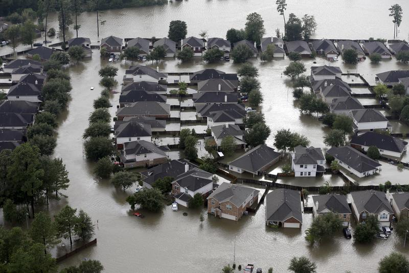 Homes are surrounded by floodwaters from Tropical Storm Harvey in Spring, Texas, in August.