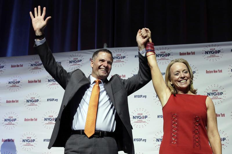 Dutchess County Executive Marc Molinaro, Republican candidate for governor, and Julie Killian, his running mate for lieutenant governor, acknowledge delegates' applause at the New York state Republican Convention, in New York, Wednesday.
