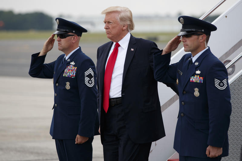 President Donald Trump steps off Air Force One after arriving at Long Island MacArthur Airport in Ronkonkoma, N.Y., in July to speak on MS-13. Trump returns to Long Island Wednesday for a forum on the violent street gang.