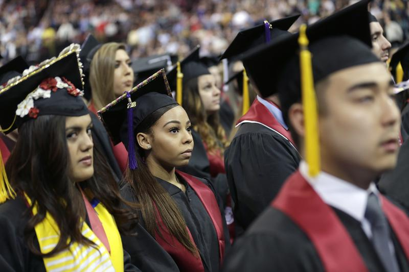 New graduates participate in an undergraduate commencement ceremony for Ramapo College in Newark, N.J., in May.