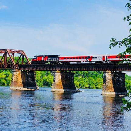 A Hartford Line train cross the Connectivue River Bridge between Windsor Locks and East Windsor.