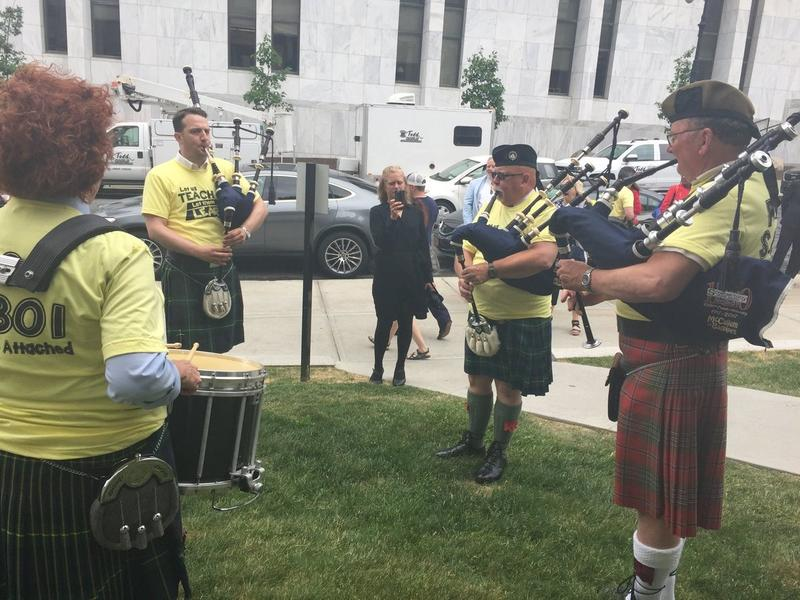 Bagpipers hired by the New York State United Teachers union play outside the Capitol in Albany, N.Y., on Wednesday.