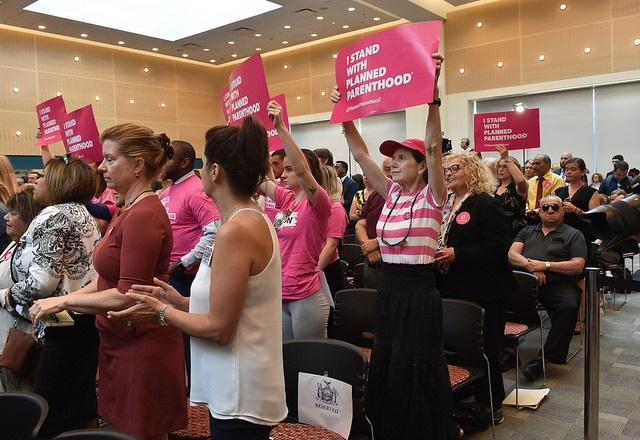 Planned Parenthood advocates at a rally, also held on Wednesday, in Farmingdale where Governor Cuomo, Lieutenant Governor Kathy Hochul and Suffolk County leaders vowed to fight to protect women's reproductive rights.