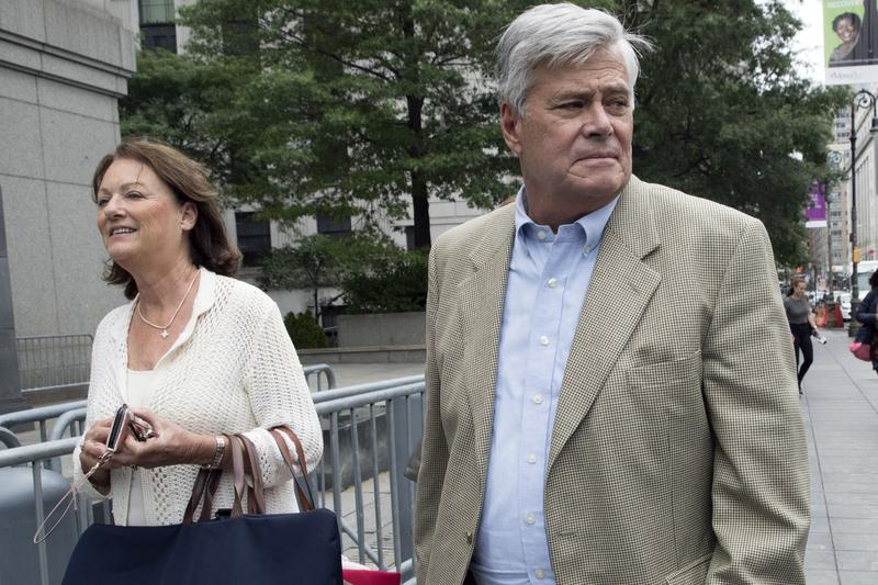 Former New York Senate Majority Leader Dean Skelos, right, and his wife, Gail, leave federal court last week in New York.