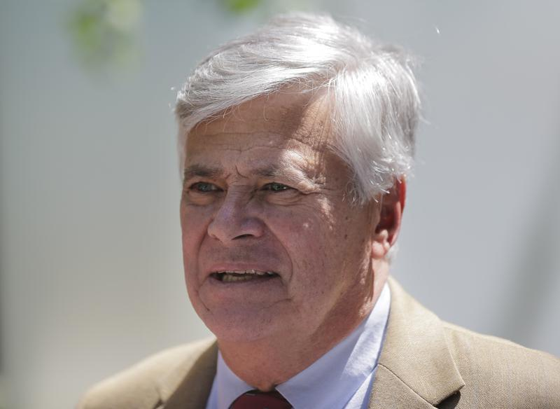 "Dean Skelos leaves federal court in New York on Tuesday. The former State Senate leader and his son got business executives to arrange no-show jobs for the son in what a federal prosecutor called a brazen ""family shakedown."""
