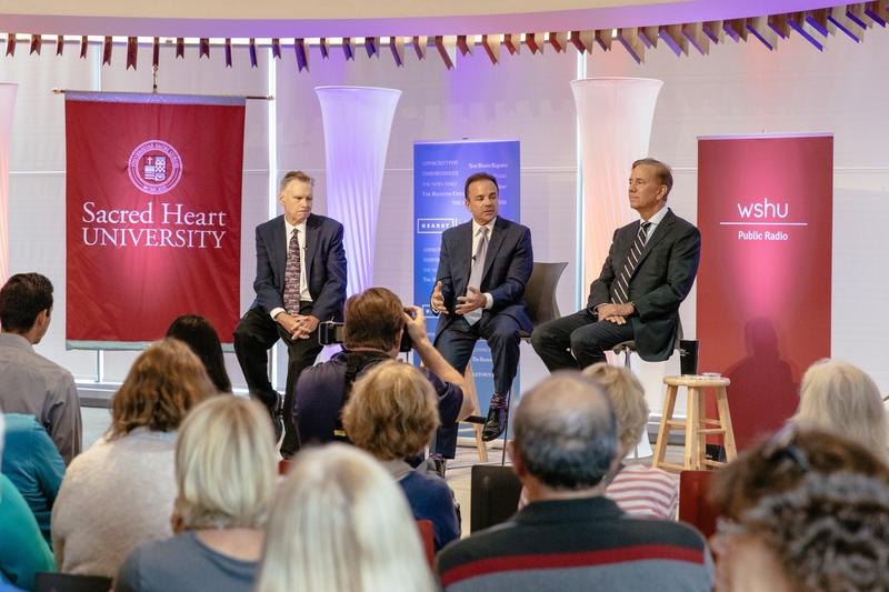 The Democratic candidates for Connecticut governor, Joe Ganim, center, and Ned Lamont, right, participate in a debate, moderated by Ken Dixon, Hearst Connecticut Media Group political editor and columnist, left, at Sacred Heart University on Thursday.