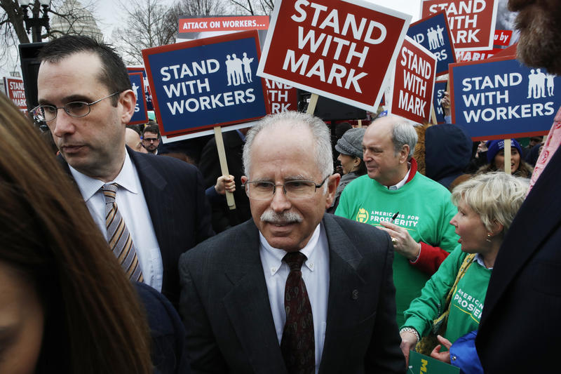 Illinois government employee Mark Janus, center, outside the Supreme Court in Washington in February. In a financial blow to labor, the court ruled in June that states can't force government workers to pay union fees.