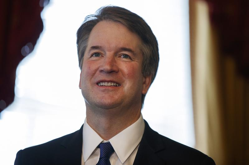Supreme Court nominee Brett Kavanaugh smiles during a meeting with Sen. Orrin Hatch, R-Utah, on Capitol Hill on Wednesday in Washington.