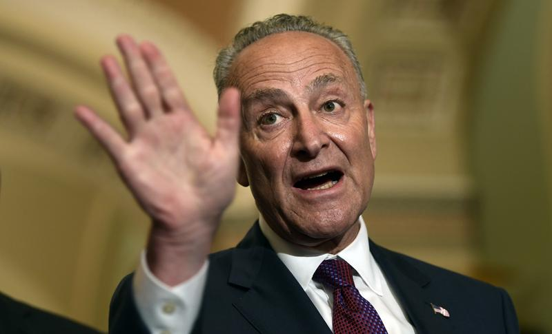Sen. Chuck Schumer speaks to reporters on Capitol Hill on Tuesday about his opposition to Brett Kavanaugh, President Trump's Supreme Court pick. Schumer says his opposition is about health care.