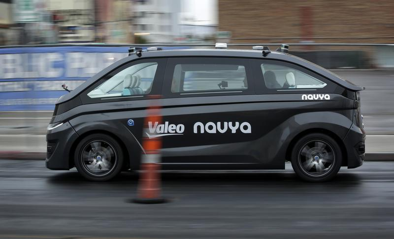 A Navya Autonom Cab, a self-driving vehicle, drives down a street during a demonstration at CES International in January in Las Vegas.