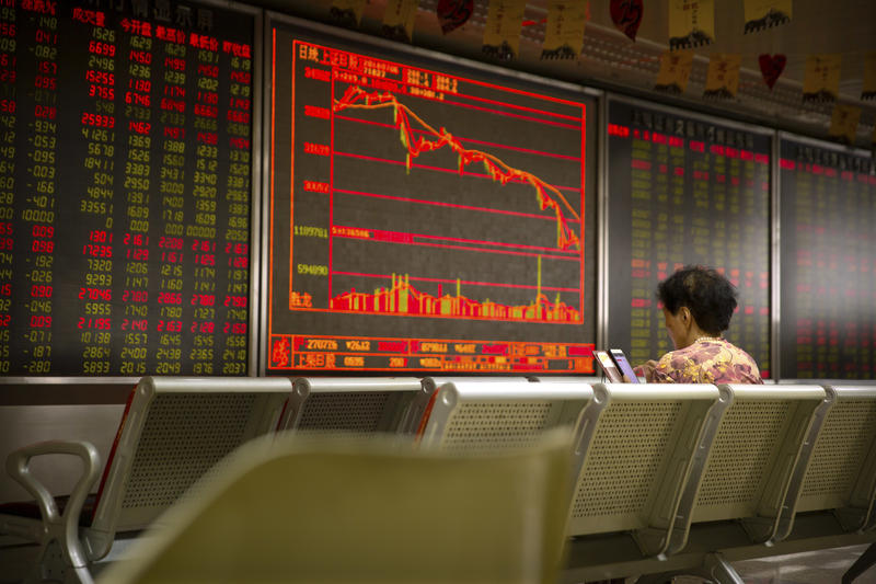 A Chinese investor monitors stock prices in Beijing on Friday. President Trump said that U.S. tariffs against Chinese imports will take effect early Friday and that he's prepared to sharply escalate a trade war between the world's two biggest economies.