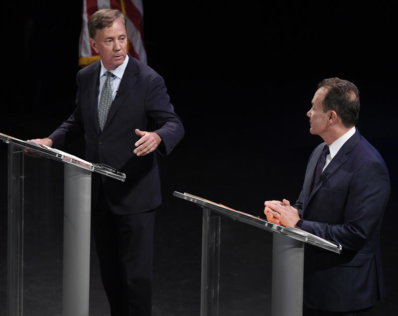 File Photo- Democratic candidate for governor Ned Lamont, left, debates with Bridgeport Mayor Joe Ganim in New Haven, Conn., Thursday, July 12, 2018. Lamont is the party's endorsed candidate, while Ganim petitioned his way onto the Aug. 14 ballot.
