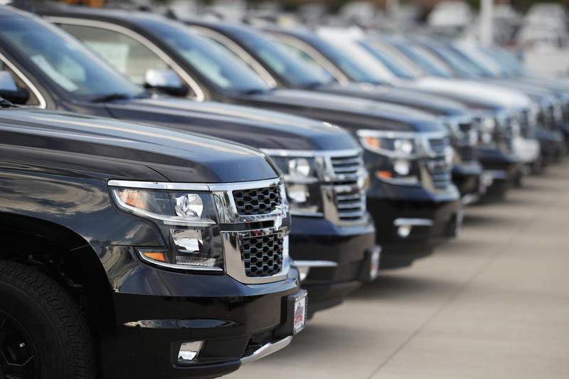 unsold 2018 Suburbans sit at a Chevrolet dealership in June.