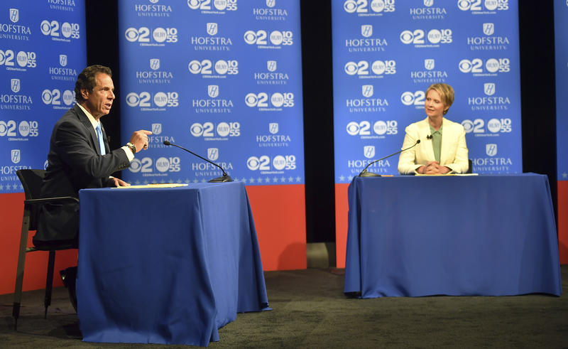 New York Gov. Andrew Cuomo speaks at the Democratic gubernatorial primary debate as his challenger, Cynthia Nixon, listens, Wednesday at Hofstra University in Hempstead, N.Y.