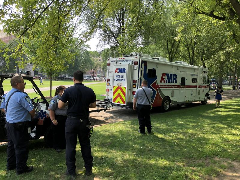 Emergency medical technicians monitor the New Haven Green for new cases on Thursday.
