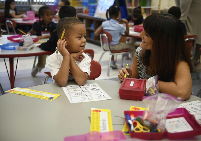 Elionet Saez Martin, of Puerto Rico works with his kindergarten teacher Rachael Leupold at Chamberlain Elementary School in New Britain, Conn.