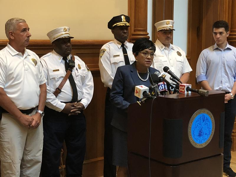 New Haven Mayor Toni Harp and other city officials hold a press conference Thursday on the mass overdose that occured earlier this week in New Haven. Investigators still don't know what was in the drugs that sickened so many.