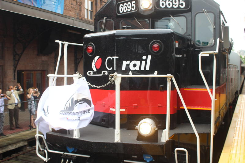 A CTrail train from New Haven breaks a ceremonial tape at Hartford's Union Station on June 15, 2018, to mark the opening of the new commuter line linking New Haven, Hartford and Springfield, Mass.