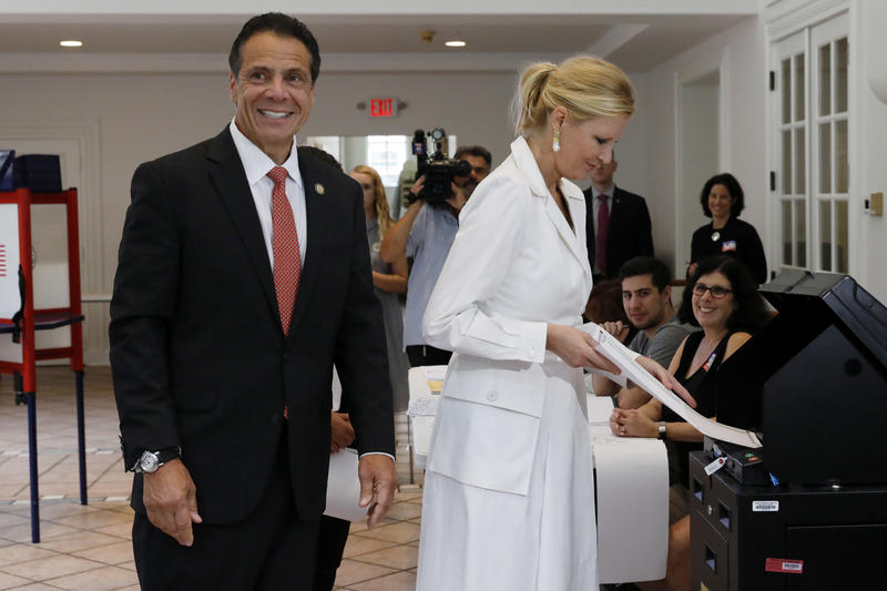 New York Gov. Andrew Cuomo waits as his girlfriend Sandra Lee has her primary election ballot accepted by a scanner, at the Presbyterian Church of Mount Kisco, in Mt. Kisco, NY, Thursday.