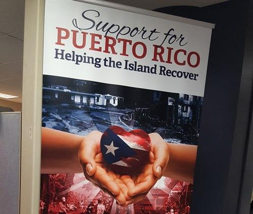 A sign asking for donations for Hurricane Maria relief inside the Puerto Rico Relief Center in Bridgeport earlier this year.