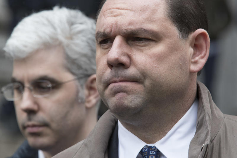 Joseph Percoco, right, a former top aide to New York Gov. Andrew Cuomo, reacts while talking to reporters outside U.S. District court in March in New York.