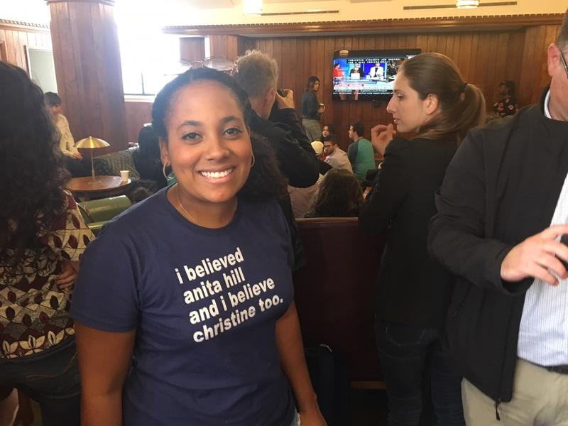 Veronica Guerrero, a student at Yale Law School and an organizer for the group Yale Law Students Deserve Better, gets ready to watch Christine Blasey Ford's testimony with fellow students Thursday on the Yale campus.