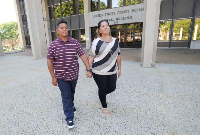 Martinez v. Malloy plaintiffs Jose Martinez and Jessica Martinez outside the federal courthouse in Bridgeport in 2016.