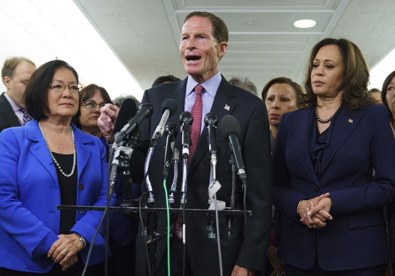 Senate Judiciary Committee member Sen. Richard Blumenthal, D-Conn., joined by Sen. Kamala Harris, D-Calif., right, and Sen. Mazie Hirono, D-Hawaii, left, speaks about the Senate Judiciary Committee hearing on Judge Brett Kavanaugh on Capitol Hill Friday.