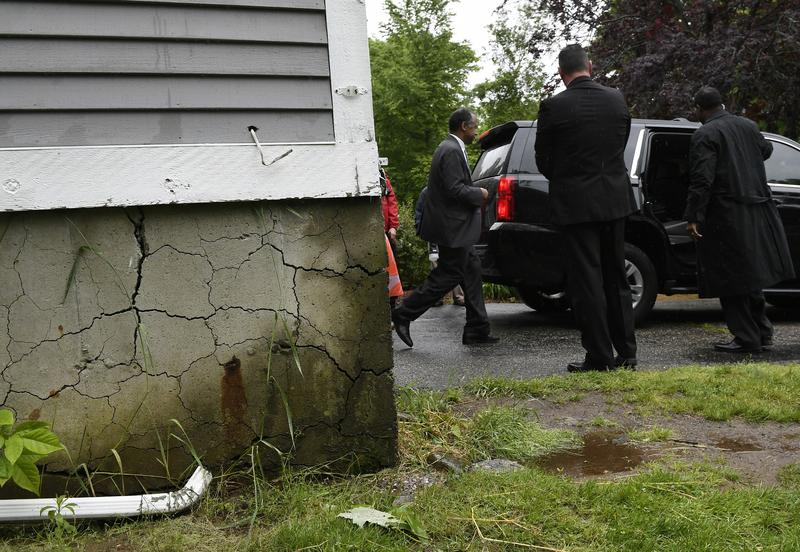 Housing and Urban Development Secretary Ben Carson leaves a home with a crumbling foundation in Willington in June.
