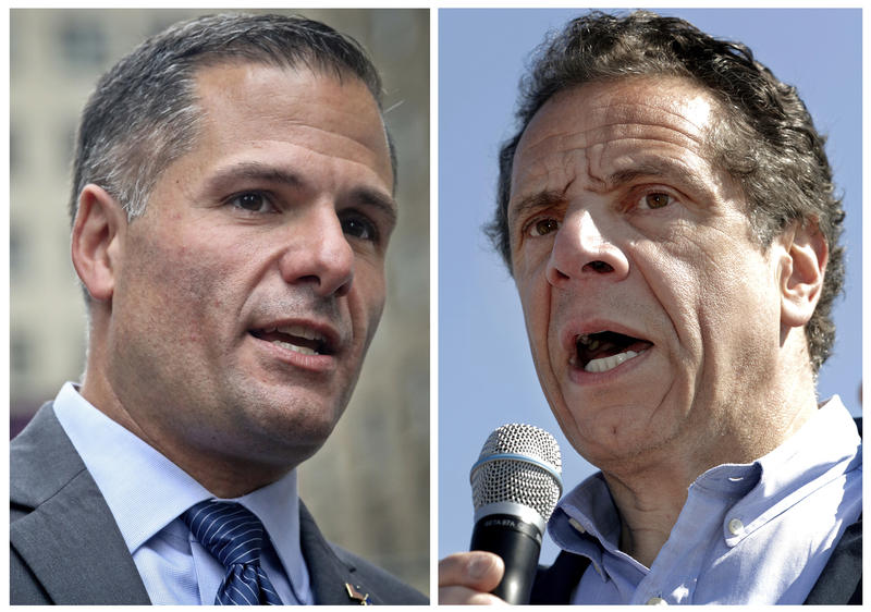 New York Republican gubernatorial candidate Marc Molinaro, left, speaks at a news conference in New York in Sept., and New York Gov. Andrew Cuomo, right, speaks in Tarrytown in May.
