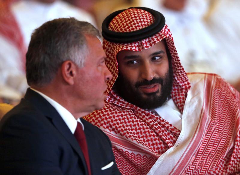 Jordan's King Abdullah II, left, listens to Saudi Crown Prince Mohammed bin Salman at the Future Investment Initiative conference in Riyadh, Saudi Arabia, on Tuesday.