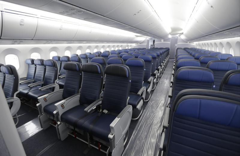 Economy class seating is shown on a new United Airlines Boeing 787-9 undergoing final configuration and maintenance work in 2016.