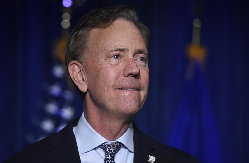 "Governor-elect Ned Lamont reacts when speaking to supporters in Hartford Wednesday. Lamont won election as Connecticut's governor, keeping the office in Democratic hands in part by promising to be a ""firewall"" against the policies of President Trump."