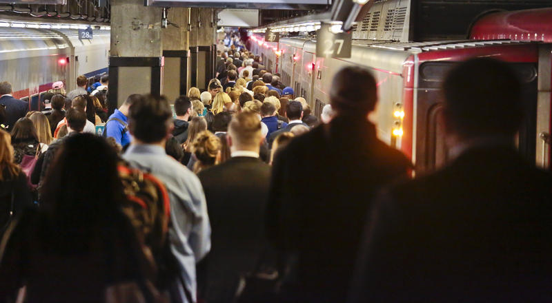 Passengers board a Metro-North train at Grand Central Terminal in 2016. Commuters into and out of the terminal faced delays, a day after a fire broke out beneath elevated train tracks in the city.