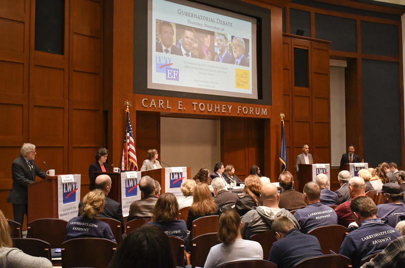 Candidates for governor of New York from left, Green Party Howie Hawkins, Independent Stephanie Miner, Moderator Laura Ladd Bierman, Libertarian Larry Sharpe, and Republican Marc Molinaro, participate in the last scheduled debate before Election Day.