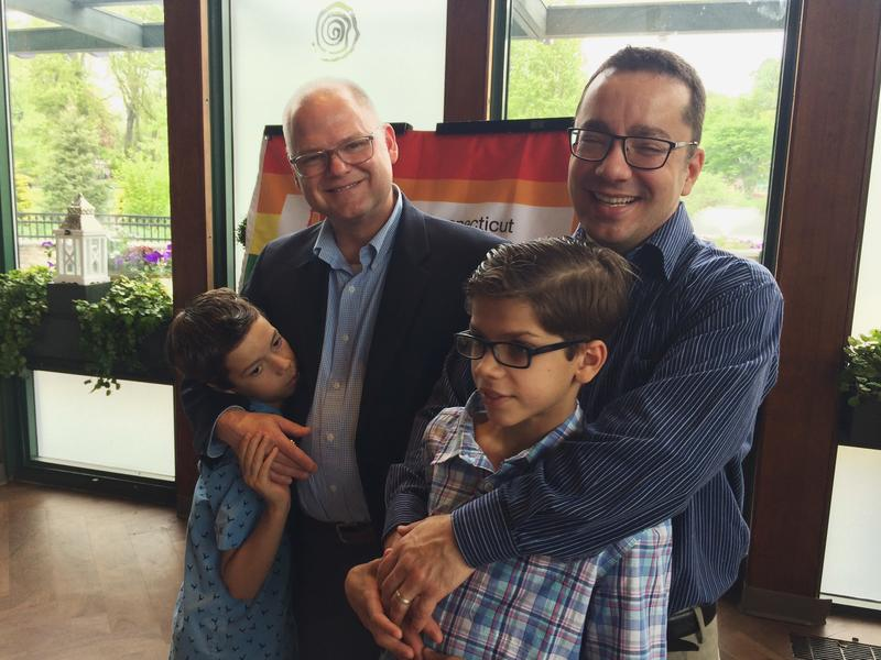 Shannon Smith, left, poses with his husband, Ross Stencil, and the couple's two adopted sons, Giovanny, left, and Louis in May at a Department of Children and Families event to encourage same sex couples to apply to become foster and adoptive parents.