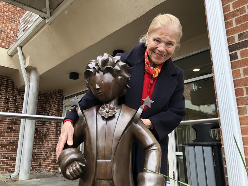 Yvette Cariou O'Brien and the statue of the Little Prince she helped bring to Northport, Long Island.