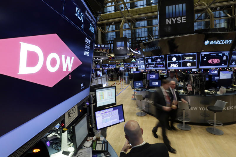 The chemical company Dow appears above its trading posts on the floor of the New York Stock Exchange. Dow is named in a pollution lawsuit recently brought by several Long Island municipalities.