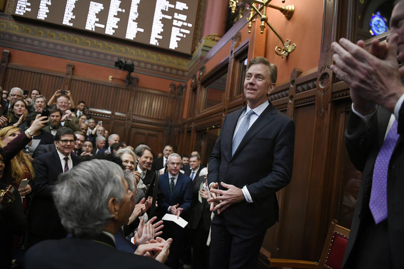 Connecticut Gov. Ned Lamont arrives in the Hall of the House at the State Capitol in Hartford Wednesday.