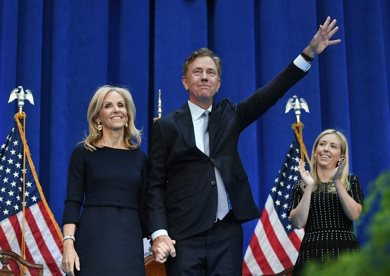 Connecticut Gov. Ned Lamont waves as he stands with wife Annie after taking the oath of office, Wednesday inside the William A. O'Neill Armory in Hartford.