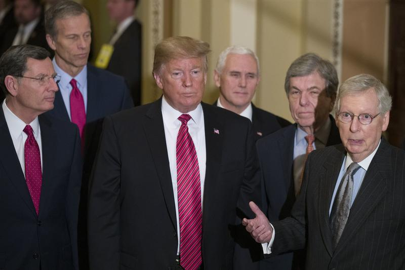 Sen. John Barrasso, R-Wyo., left, Sen. John Thune, R-S.D., President Donald Trump, Vice President Mike Pence, Sen. Roy Blunt, R-Mo., and Senate Majority Leader Mitch McConnell of Ky., after a Senate Republican Policy lunch on Wednesday.