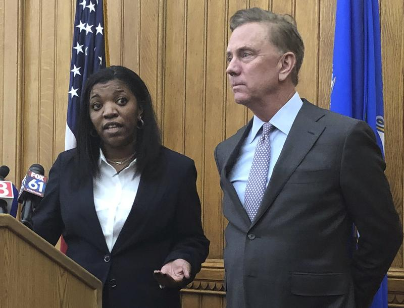 Vanessa Dorantes speaks at the Connecticut State Capitol, Monday in Hartford, following the announcement by Gov.-elect Ned Lamont, right, that she has been nominated to be the next commissioner of the Department of Children and Families.