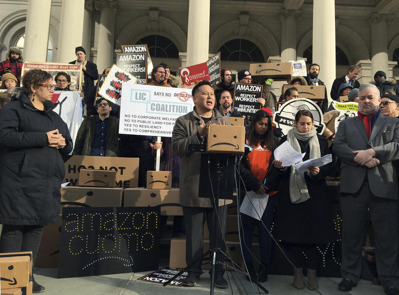 State Assemblyman Ron Kim, center, speaks at a rally opposing New York's deal with Amazon on the steps of New York's City Hall in December.