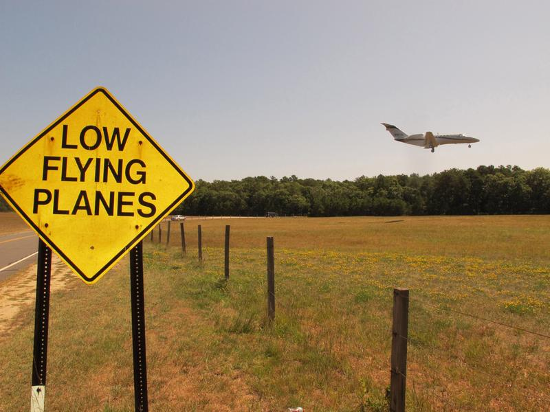 A small jet approaches the runway at East Hampton Town Airport in East Hampton, N.Y., in 2014.