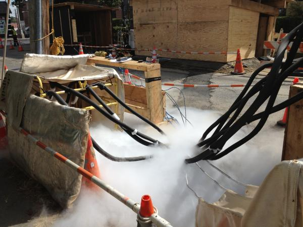 Liquid nitrogen is poured into a pit where Con Edison works on power feeder lines in Mount Vernon, NY.
