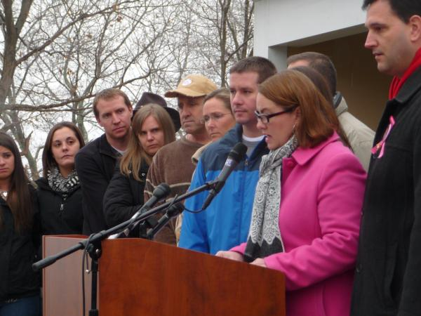 Family members of Newtown victims share a prepared statement in Sandy Hook on Monday